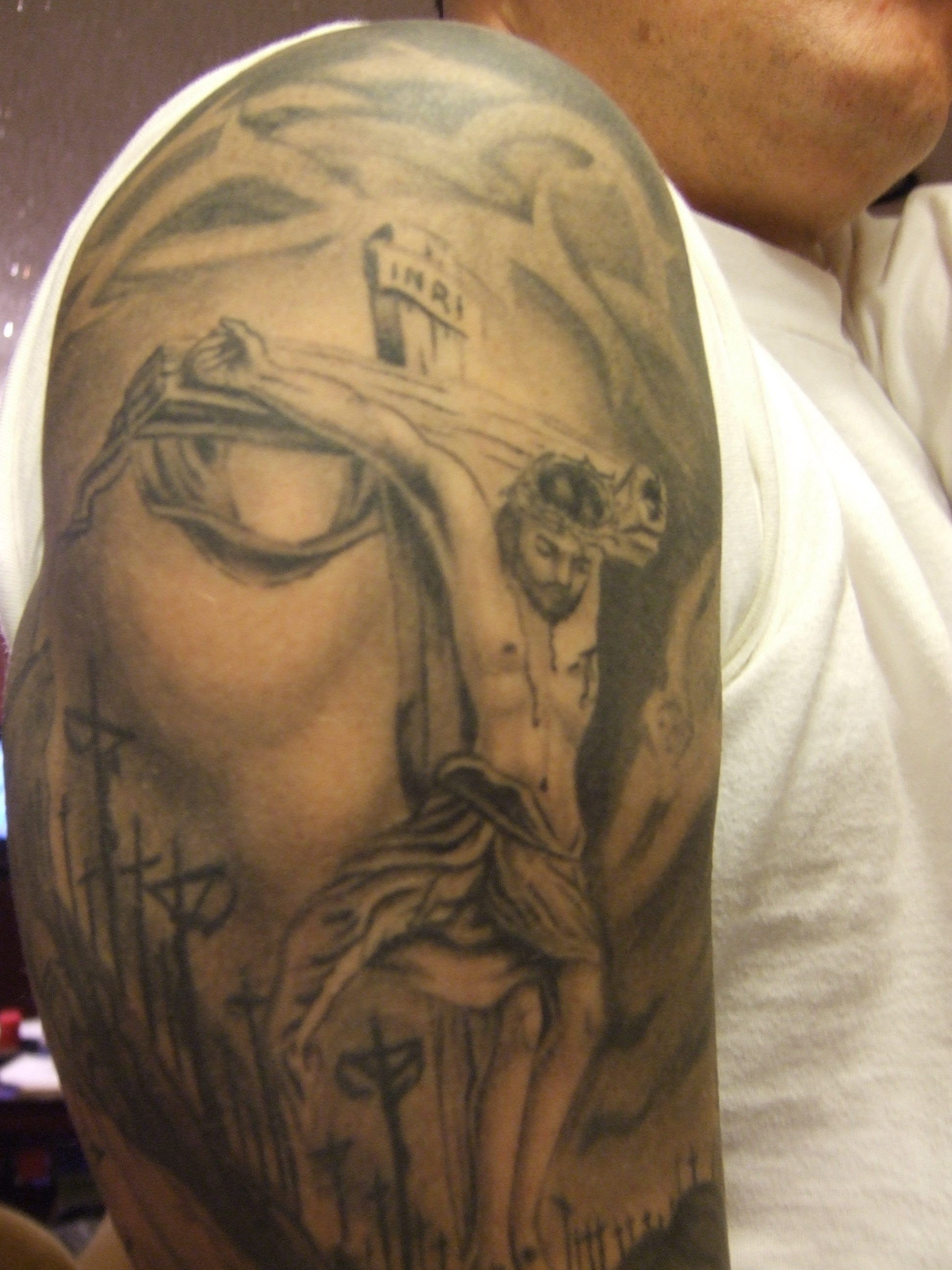 Fashion style Cross on the jesus tattoo for woman